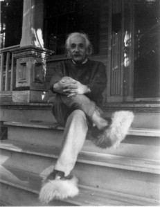 Einstein sitting on the front steps of his home in Princeton c. 1950